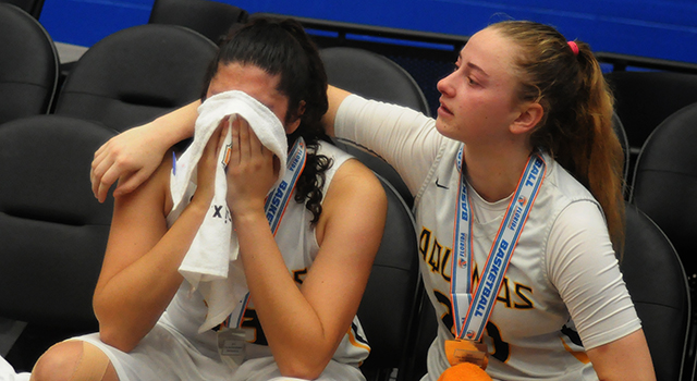 St. Thomas Aquinas senior Halie Murphy, right, consoles junior forward Angelee Rodriguez after their 58-52 overtime loss to Tampa Bay Tech in the FHSAA Class 8A Girls Basketball State Championship game on Saturday, March 2, 2019, at the RP Funding Center in Lakeland. (Lynn Ramsey | FC)