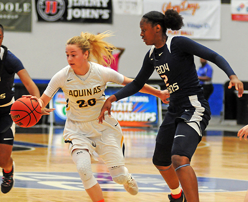 St. Thomas Aquinas' Halie Murphy tries to move around Tampa Bay Tech's Janiah Barker in the first half of Tampa Bay Tech's 58-52 overtime victory Saturday, March 2 in the FHSAA Class 8A girls basketball state championship game at the RP Funding Center in Lakeland.