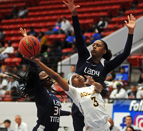 St. Thomas Aquinas guard Samara Spencer (3) tries for a layup between Tampa Bay Tech's Amiya Evans, left, and Janiah Barker in the first half of Tampa Bay Tech's 58-52 overtime victory March 2 in the FHSAA Class 8A girls basketball state championship game at the RP Funding Center in Lakeland.