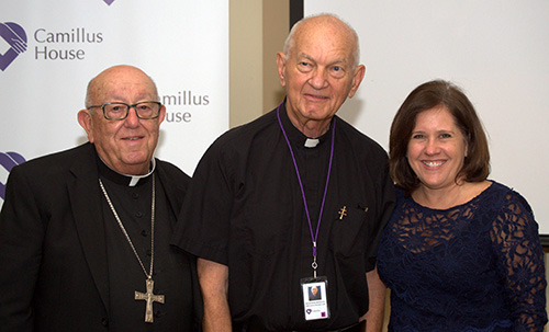 Hospitaller Brother Raphael Mieszala, center, poses for photos with fellow workers at Camillus House after his farewell Mass. Posing with him are retired Miami Archbishop John C. Favalora, who volunteers at the central shelter twice a week; and Hilda Fernandez, CEO of Camillus House.