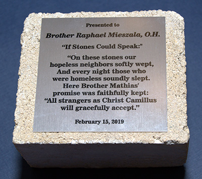 This short poem, inscribed on a block of Camillus House, was presented to Hospitaller Brother Raphael Mieszala at his farewell reception.