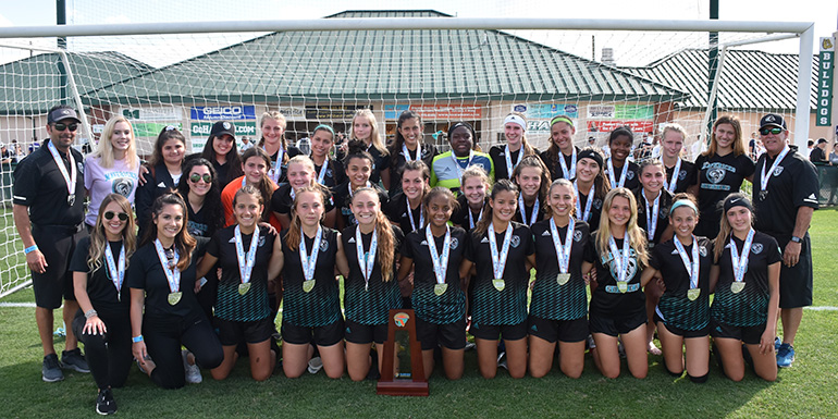 Archbishop McCarthy High's girls soccer team pose with their coaches and state championship runner-up trophy after battling Montverde to a 0-1 score in the Feb. 22 final.