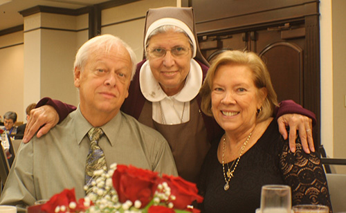 Sister Carmen Ors, of the Servants of the Pierced Hearts of Jesus and Mary, poses with her former boss, retired Respect Life director Joan Crown, and Crown's husband, Chic, at the Miami Archdiocesan Council of Catholic Women's 20th annual Scholarship Luncheon, held Feb. 23 at the Embassy Suites in Fort Lauderdale.