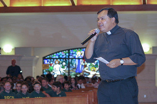 Father Elvis Gonzalez, director of vocations for the Archdiocese of Miami, welcomes students to the Focus 11 vocations rally Feb. 27 at host St. Gregory Parish in Plantation.