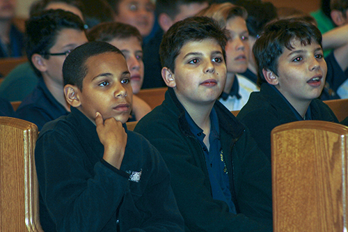 Sixth graders enjoy talks by seminarians during the  Focus 11 vocations rally Feb. 27 at host St. Gregory Parish in Plantation.