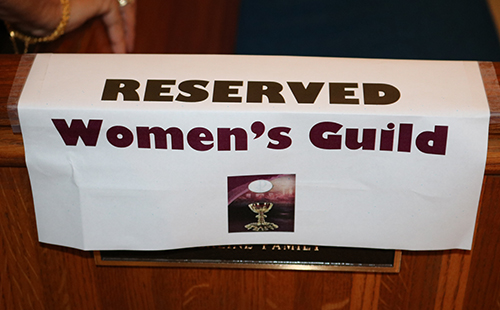 A sign marks a pew reserved for members of the St. Anthony Women's Guild.