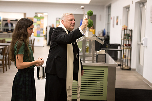 Miami Archbishop Thomas Wenski blesses the new parish and student center facilities at Mary Help of Christians Parish in Parkland, serving northwestern Broward County. The event was held March 4.