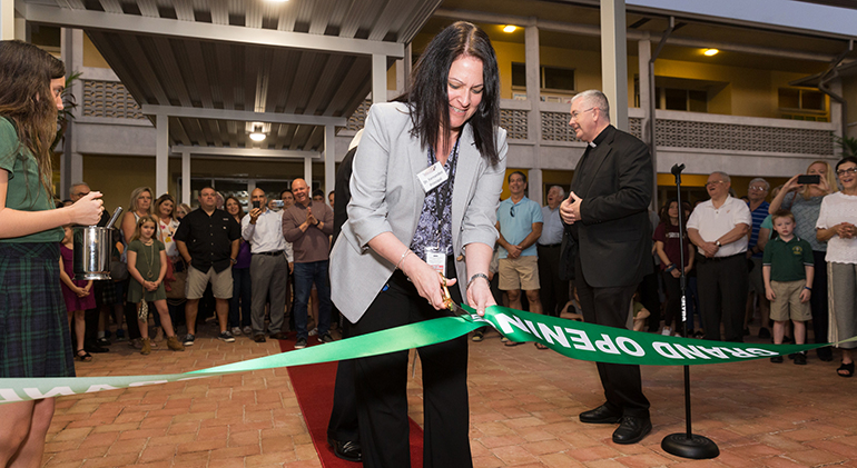 Alexandra Fernandez, principal, cuts the ribbon March 4 during the official blessing and opening of Mary Help of Christians Catholic School Parish & Student Center in Parkland. Miami Archbishop Thomas Wenski blessed the facilities serving northwestern Broward County during a ribbon cutting ceremony.