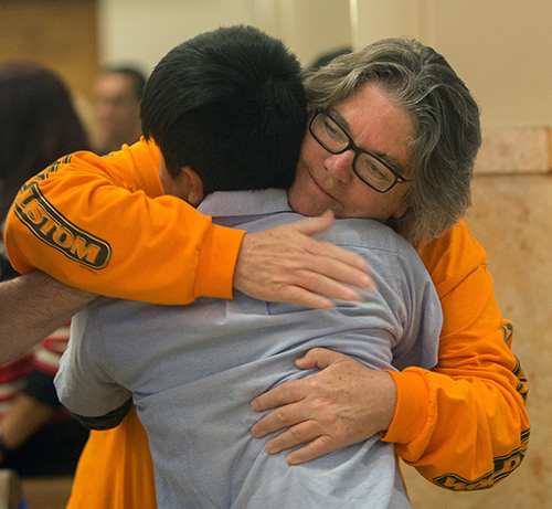 Rose Anderson, sponsor, hugs Juan Tito Benito, 12, a Guatemalan who came to the U.S. as an unaccompanied minor in 2017.