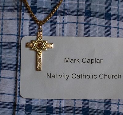 The cross bearing the star of David medal which Mark Caplan wears around his neck.
