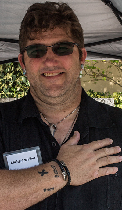 Michael Walker, a catechumen who almost died in 2017, displays a tattoo with the date of his near-death experience, 4-12-17.