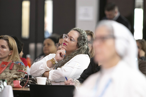 Participants listen to the keynote talk by Sister Miriam James Heidland of the Sisters of Our Lady of the Most Holy Trinity, during the archdiocesan Evangelization Summit, March 16, 2019, at Msgr. Edward Pace High School in Miami Gardens.