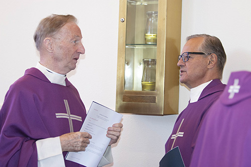 Past presidents of St. Thomas University, Father Patrick O'Neill, left, and Msgr. Franklyn Casale, talk before the Mass that preceded the inauguration of David A. Armstrong as 10th president of St. Thomas University, Miami Gardens, March 20, 2019.