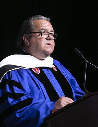 John J. Dooner, a 1970 alumnus who now chairs the Board of Trustees of St. Thomas University, speaks at the inauguration of David A. Armstrong as the school's 10th president, March 20, 2019.