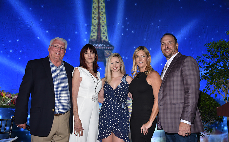Cardinal Gibbons Principal Paul D. Ott, far left, and the Smith family after the announcement of their $ 750,000 gift at the school's Evening in Paris fundraising dinner March 23, 2019. From left: Susan Smith, Kaelin Kelley, Gibbons class of '19, Shawn Smith-Myers, class of '89, and Charlie Myers.