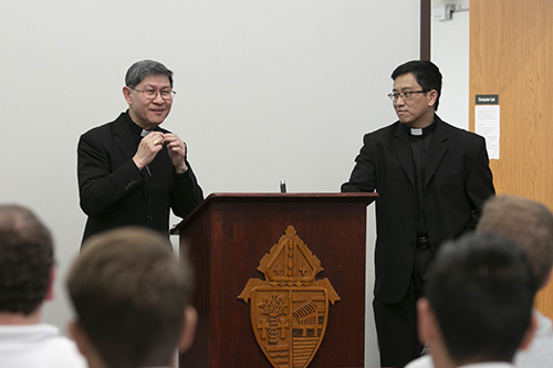 Father Ferdinand Santos, right, rector of St. John Vianney College Seminary in Miami, accompanies Cardinal Luis Antonio Tagle of Manila during a brief meeting with seminarians and staff the afternoon of March 22. The two have known each other for a number of years.