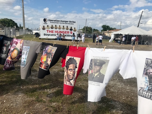 Images of victims of gun violence in urban communities hang on Tshirts at the Liberty City site of Operation Hunger Strike, staged by nine men who are part of a group called The Circle of Brotherhood. The Hunger 9 ended their strike March 29, saying the news and social media attention had made a difference. Archbishop Wenski visited the men March 24.