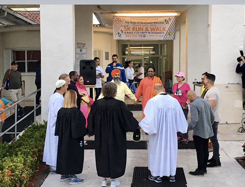 Leaders from 10 religious institutions in Southwest Ranches, including Archbishop McCarthy High, St. Mark Church and School, and the Archdiocese of Miami, take part in a unity prayer before the start of the 5K Run and Walk  March 30.