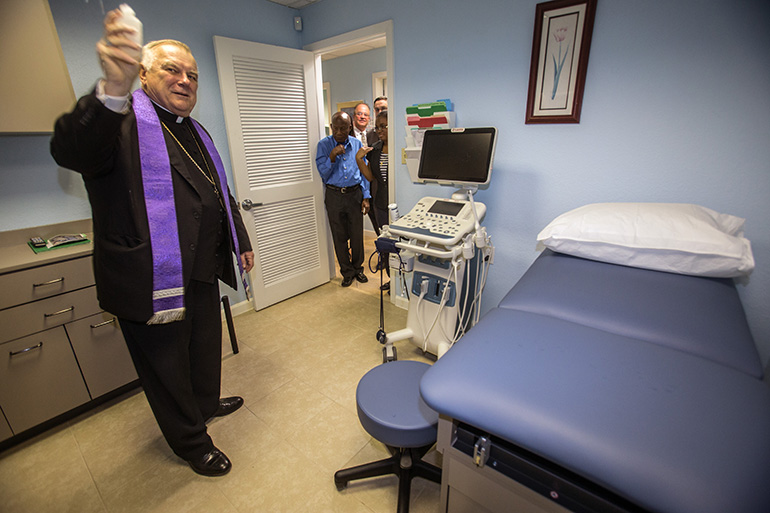 Archbishop Thomas Wenski blesses the new ultra sound machine at the Central Broward Pregnancy Help Center April 12, 2019.