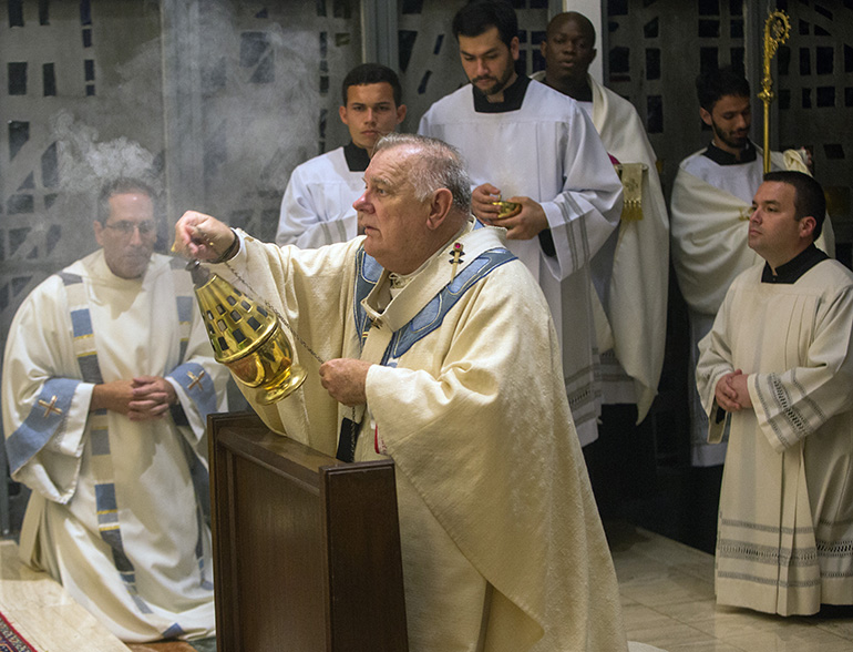 Archbishop Thomas Wenski censes the tabernacle where the Blessed Sacrament is exposed at the conclusion of Holy Thursday Mass of the Last Supper at St. Mary Cathedral.