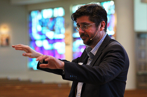 Richard Robbins, guest conductor at the American Federation Pueri Cantores Miami Choral Festival and Mass at St. Bonaventure Church, Davie, directs students during rehearsal March 30.