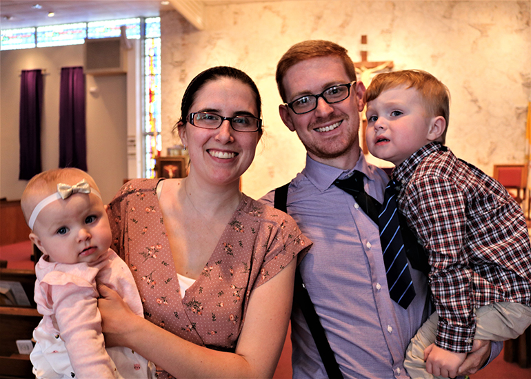 Christopher and Kristin Booty attend Mass at Blessed Sacrament Church in Oakland Park with their babies, Catherine and Maythan. The family are Muslims and are converting to Catholicism. They will all be baptized during the Easter Vigil.