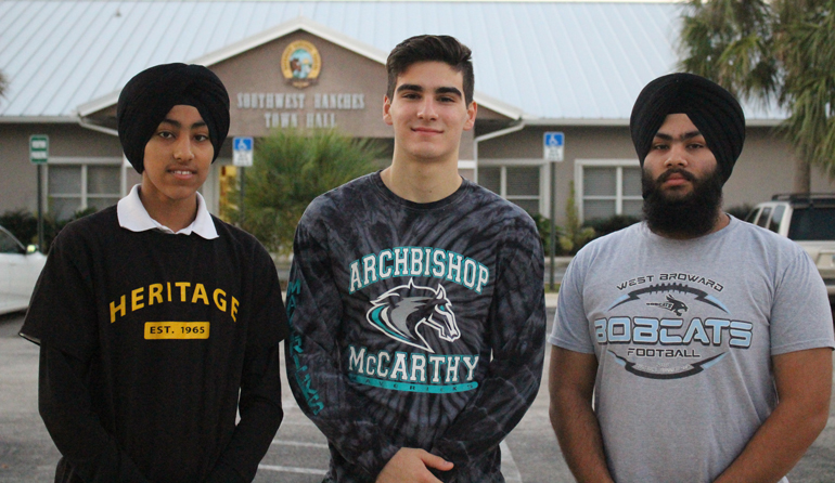 A town, two Sikhs, and a Catholic: Pavitpaul Singh, Nikolas Garcia and Jashanpreet Singh stand outside of Southwest Ranches town hall after meeting to discuss the Unity in Diversity 5K race.