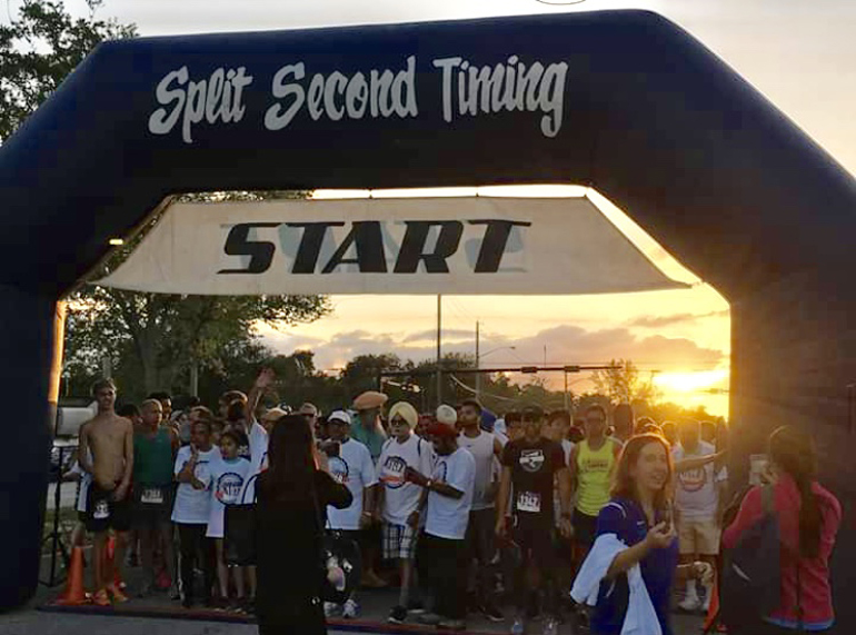 Runner's at the ready: Participants of the Unity in Diversity 5K race eagerly await at the starting line.