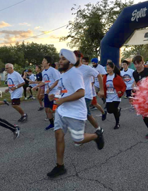 And they're off: Runners and walkers head out from the starting line at the Unity in Diversity 5K race held March 30 in Southwest Ranches.