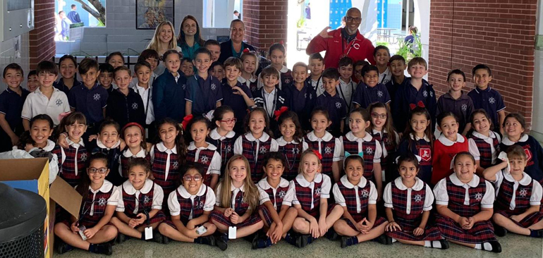 What a STREAM Day: First graders from St. Brendan School and their teachers stop for a group photo at Christopher Columbus High, where they spent the day experimenting in the lab with Columbus High AP Chemistry teacher Ludwig Baez and his students.