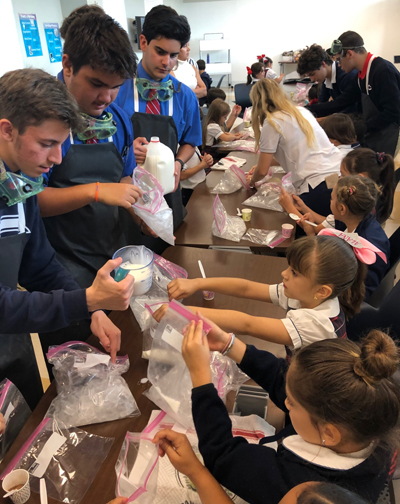 What better way to end a day of experimenting than experimenting with a little bit of homemade ice cream? Columbus High students team up with St. Brendan School first graders to make a tasty treat.