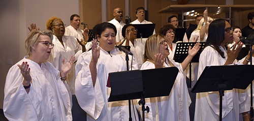 Choir sings praise and worship songs for Mass before a mortgage-burning celebration at St. Edward Church.