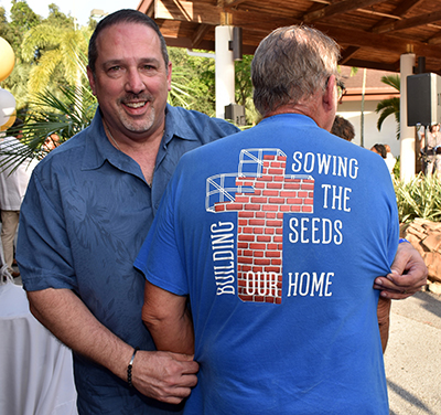William Shashaty shows off a fundraising campaign T-shirt at St. Edward Church. The church held a mortgage-burning celebration May 18.