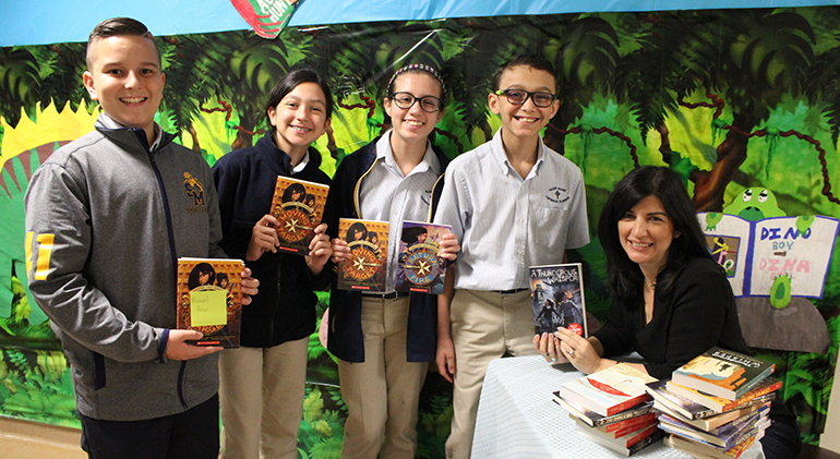 St. Mark School students Michael Anon, Alba Millon, Ayva Dow and Lewis Perez pose with their books alongside author Christina Diaz Gonzalez.