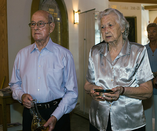 Joseph Gunther, parishioner since 1969, and Antonia Stefanic, 92, parishioner since the 1950s, bring the offertory gifts during the 60th anniversary Mass for Assumption Church in Lauderdale-By-The-Sea.