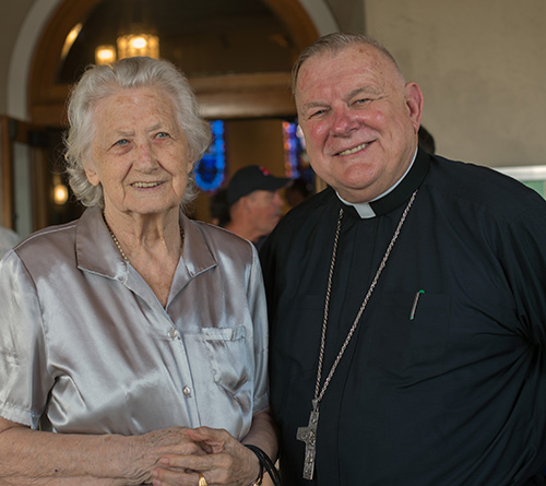 Antonia Stefanic, 92, a parishioner since the 1950s, poses for a photo with Archbishop Thomas Wenski after the 60th anniversary Mass for Assumption Church in Lauderdale-By-The-Sea.