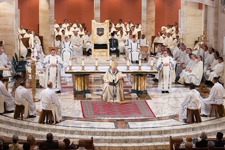 As the deacons sit around the sanctuary, Archbishop Thomas Wenski preaches his homily before a standing-room only St. Mary Cathedral, where nearly 1,000 people witnessed the joyous, tradition-filled Mass of ordination for five new priests for the Archdiocese of Miami, May 11, 2019.