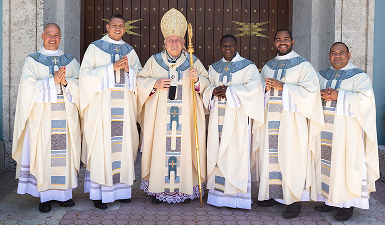 Archbishop Thomas Wenski poses with the newly ordained priests, from left: Father Elkin Sierra, Father Yonhatan A. Londoño, Father Reynold Brevil, Father Jose Enrique Lopez and Father Martin Munoz.