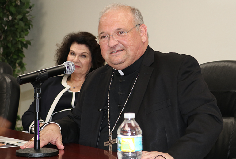 Miami Auxiliary Bishop Peter Baldacchino answers questions from the media May 16, a day after the Vatican announced he had been appointed the third bishop of the Diocese of Las Cruces, New Mexico. Behind him is Mary Ross Agosta, archdiocesan director of communications.