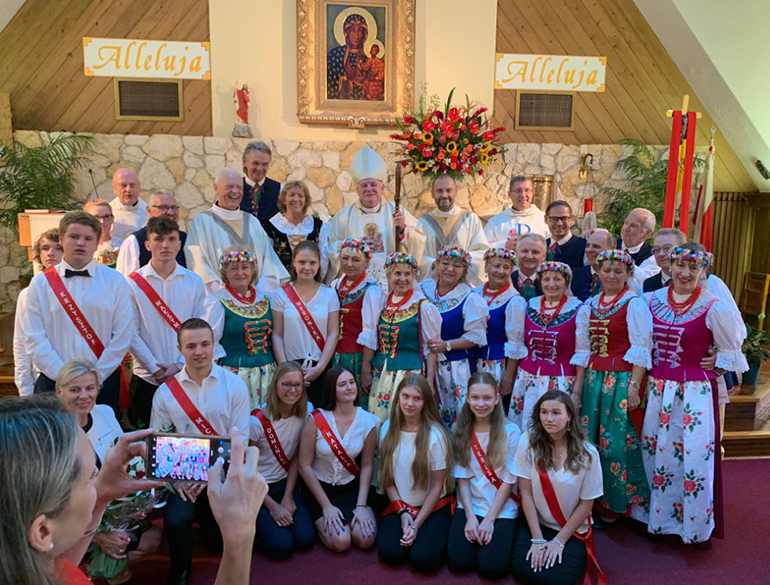 Archbishop Thomas Wenski poses with the 2019 confirmation class at Our Lady of Czestochowa Polish Mission in Pompano Beach, along with their catechists and pastor. The archbishop presided at the confirmation Mass May 19.