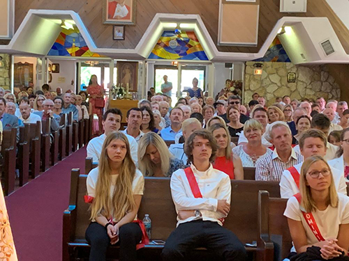 Members of the 2019 confirmation class at Our Lady of Czestochowa Polish Mission in Pompano Beach listen to his homily at the confirmation Mass May 19.