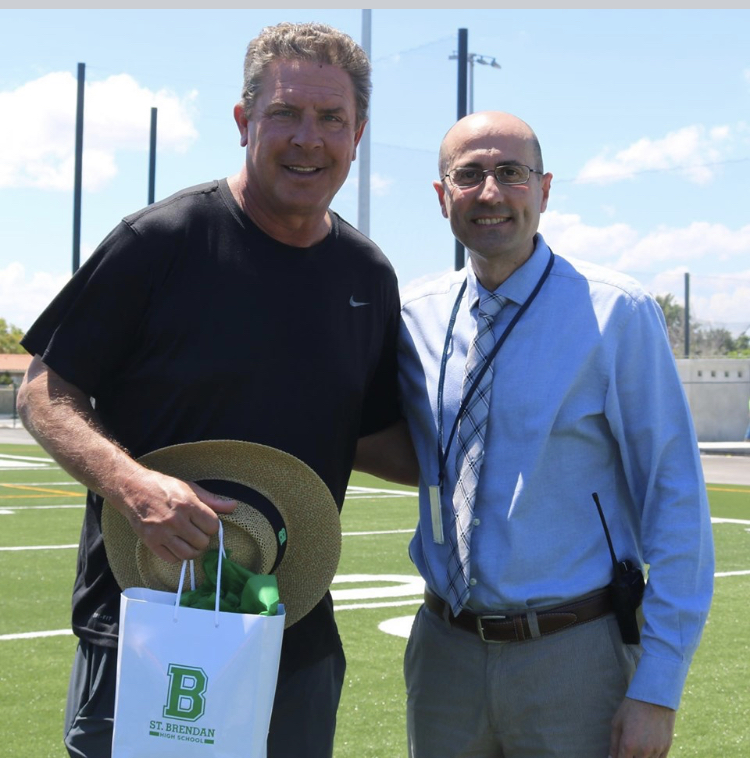 Miami Dolphins' legendary quarterback and NFL Hall of Famer Dan Marino stopped by St. Brendan High School May 21 to check out the new football and baseball fields. He also learned about the school's football program, which is just starting its second season. The new fields just had lights installed for night games, which means Friday Night Lights are coming to Westchester! Marino is pictured here with St. Brendan's principal, José Rodelgo-Bueno.