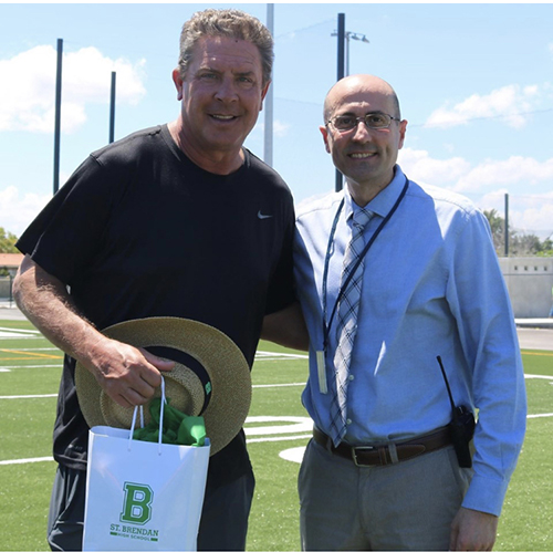 Miami Dolphins' legendary quarterback and NFL Hall of Famer Dan Marino stopped by St. Brendan High School May 21 to check out the new football and baseball fields. Marino is pictured here with St. Brendan's principal, Jose Rodelgo-Bueno.