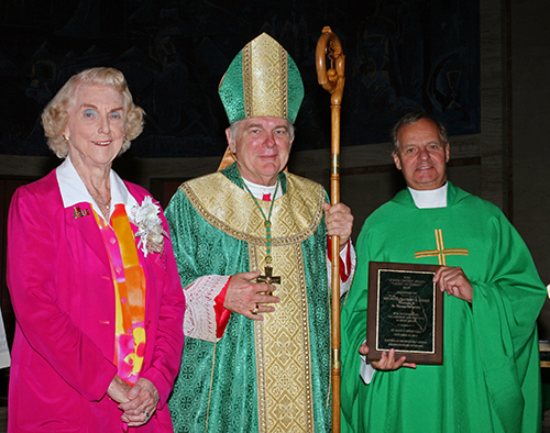 Marjorie Wessel, president of the Catholic Educators Guild, poses with Archbishop Thomas Wenski and St. Thomas University President Msgr. Franklyn Casale after he received the 2013 Lumen Christi award from the guild.