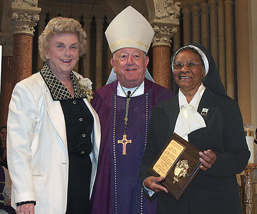 Marjorie Wessel, president of the Catholic Educators Guild, poses with Archbishop John C. Favalora and Sister Clementina Givens of the Oblate Sisters of Providence, recipient of the 2005 Lumen Christi award from the guild.