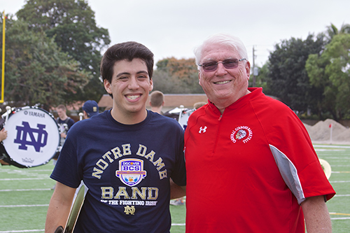 In this January 2013 photo, Paul D. Ott, Cardinal Gibbons' principal and a Notre Dame alumnus, poses with Alex Romeu, a Gibbons alumnus and member of the Notre Dame marching band. The band practiced on the Gibbons football field before their performance at the 2013 national championship bowl game against Alabama's Crimson Tide.