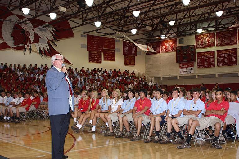 Paul Ott, seen here addressing an assembly at his alma mater, has only been away from Cardinal Gibbons High School for the four years he attended the University of Notre Dame.