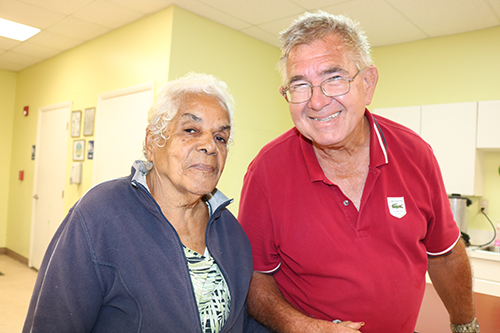 Brent Bradey walks hand in hand with his friend Delia Gonzalez, 88. He brings his friend to Centro Oeste Adult Day Care Center during the week. The center is operated by Catholic Charities. Programs at the center are for Spanish-speaking clients.