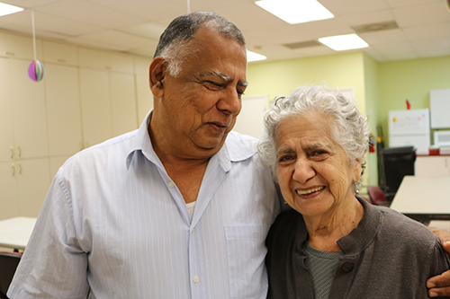 William Rojas and his mother Ruth Vidal, 85, arrive at Davie's Centro Oeste Adult Day Care Center early. Vidal brings his mother to the center during the week while he is working. He says the center is a great help to him and to his mother. He has seen her personality blossom.