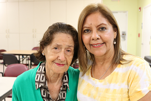 Maria Soto, 94, is shown with her daughter Clara Chavarri as she arrives at Catholic Charity's Centro Oeste Adult Day Care Center in Davie. Chavarri spoke very highly of the center saying that the ministry is a big help to her family, and her mother has  has met friends and enjoys the company and the program activities that the center offers.